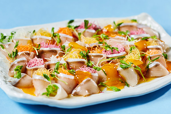 Young yellowtail and colorful salad  with orange dressing